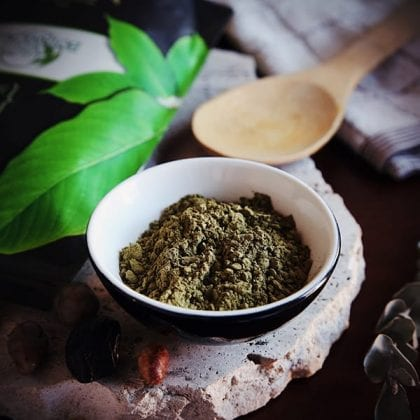 kratom powder in a bowl with a spoon and kratom ban article
